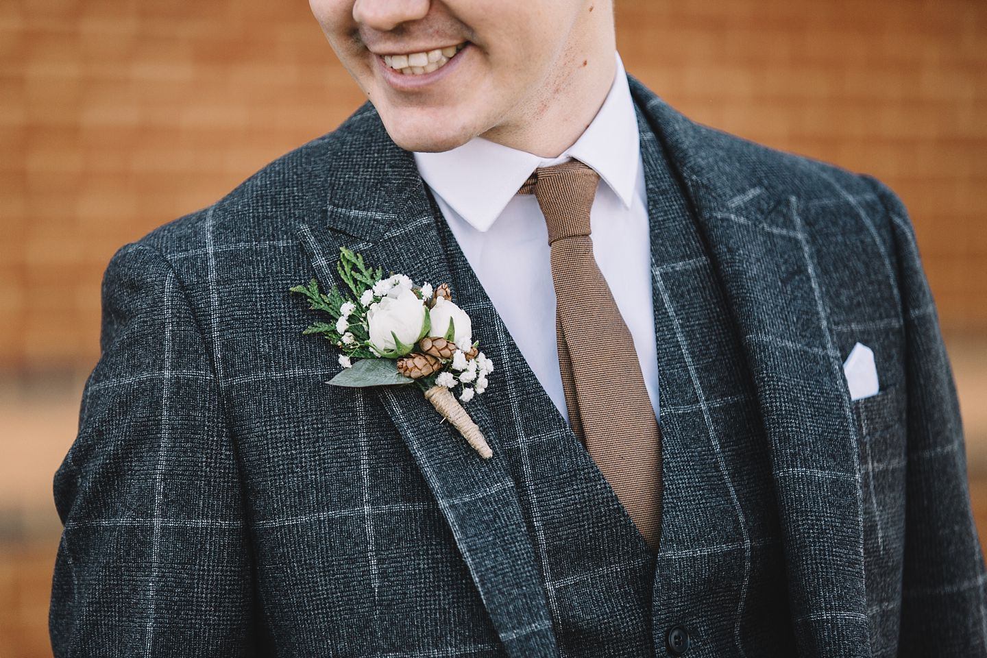 winter-groom-buttonhole-wedding-photography-vanessa-adams